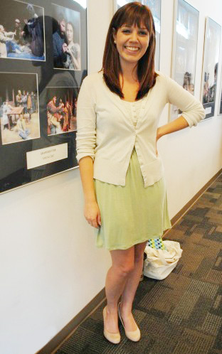 College fashionista at University of Central Florida wearing a green dress, cardigan, and nude heels