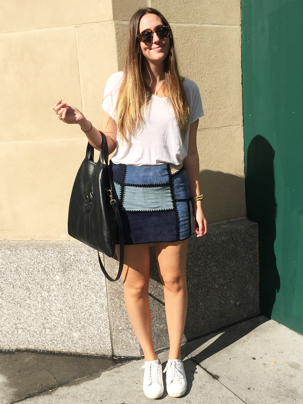 Street style at the University of Michigan - student wearing a patchwork denim skirt, glitter sneakers, and a skull bag