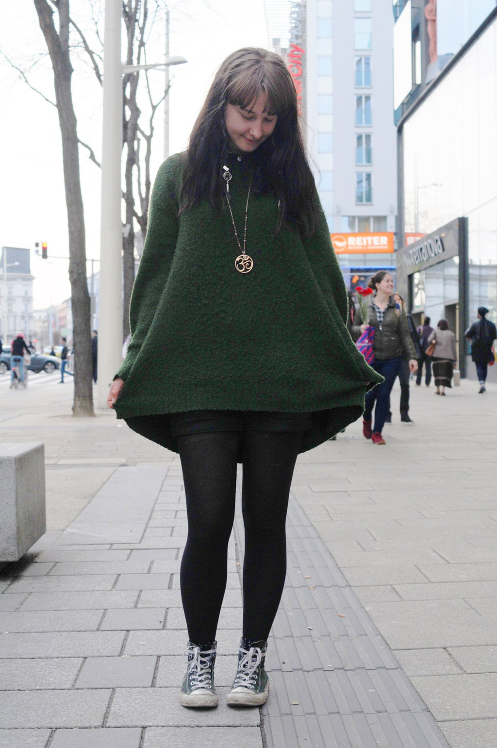 Fashion at the University of Vienna: Student Vroni wears an oversized sweater, tights, Converse, and statement jewelry