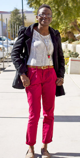 UNLV fashion - college student wearing red pants, lace top, black jacket, belt, cute necklace, leopard smoking slippers