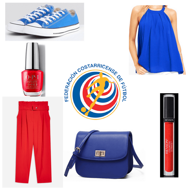 Red pants, lipstick and nail polish, blue top, sneakers and bag.