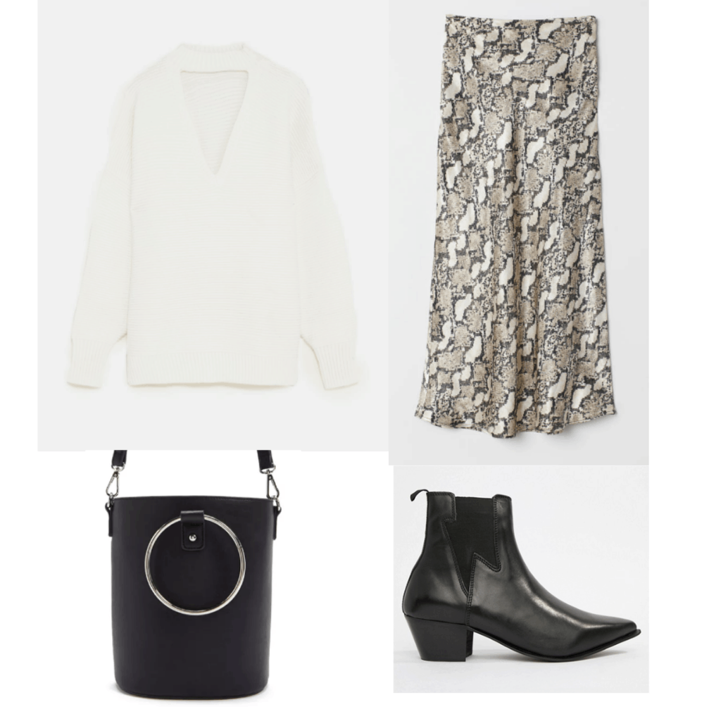Snakeskin print skirt outfit with cream colored sweater, black bucket bag, and black pointed toe ankle boots