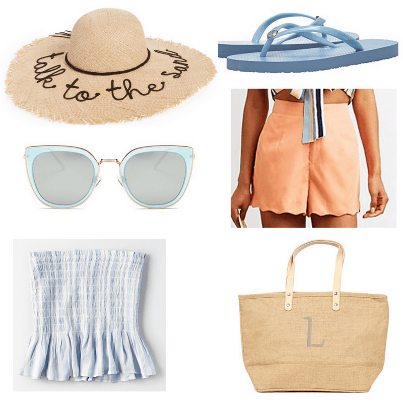 Blue top, sandals and sunglasses, coral shorts and straw bag and hat.