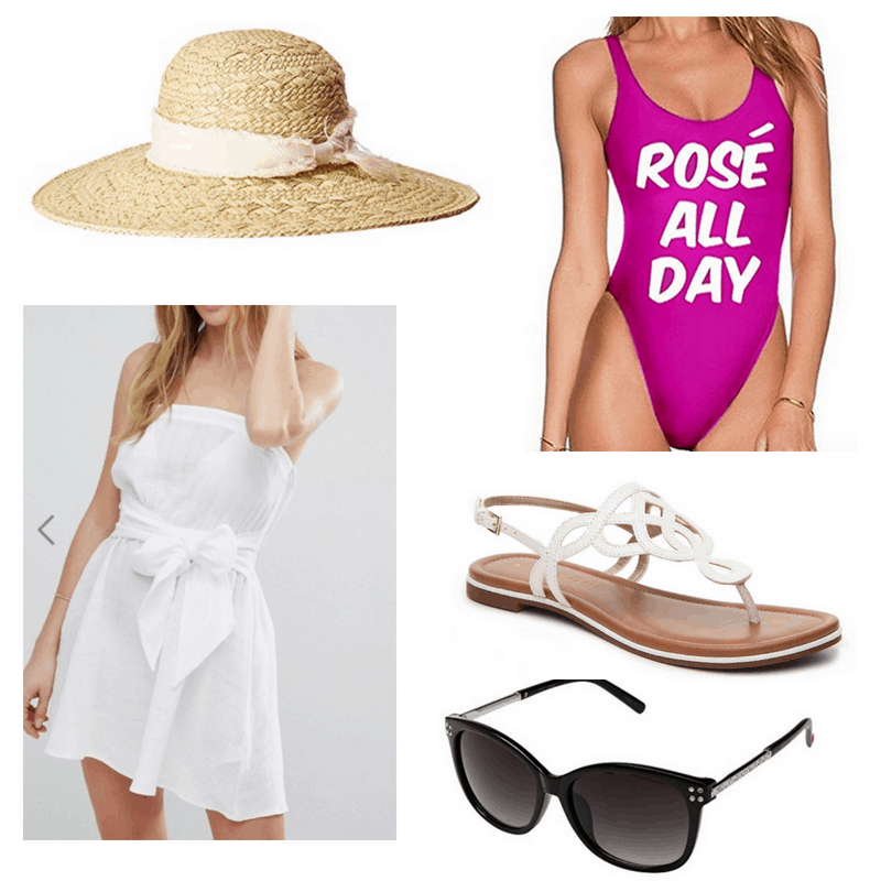 White coverup, sandals and hat, fuchsia bathing suit and black sunglasses.