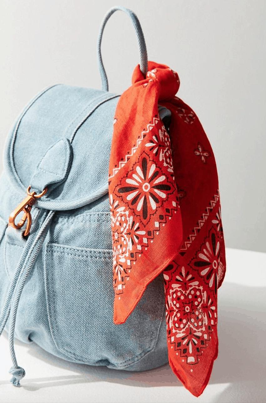 Orange bandana tied to a backpack