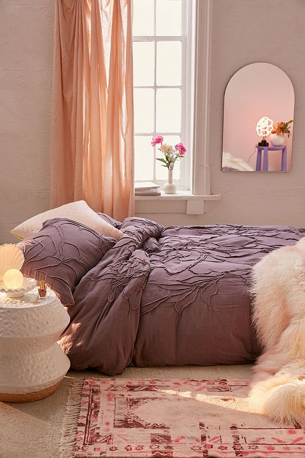 This Urban Outfitters solid dusty purple bedding has a textural roped 3D floral pattern.