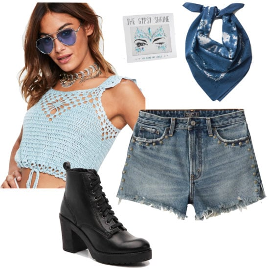 Vanessa Morgan Outfit: blue crochet crop top, blue tie dye bandana, face jewels, studded high rise jean shorts, black lace-up boots