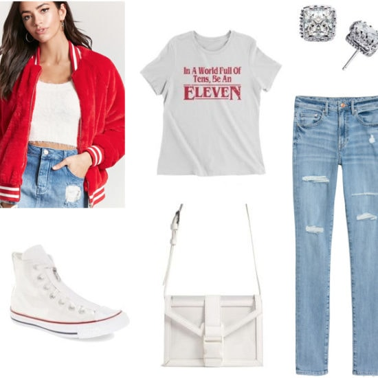 How to wear a varsity jacket to class: Outfit with light wash jeans, Eleven from Stranger Things tee shirt, faux diamond stud earrings, high top white converse sneakers, red varsity jacket, white purse