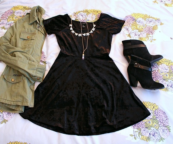 Velvet black dress green utility jacket layered necklaces black ankle boots