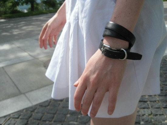 white skirt and black bracelet