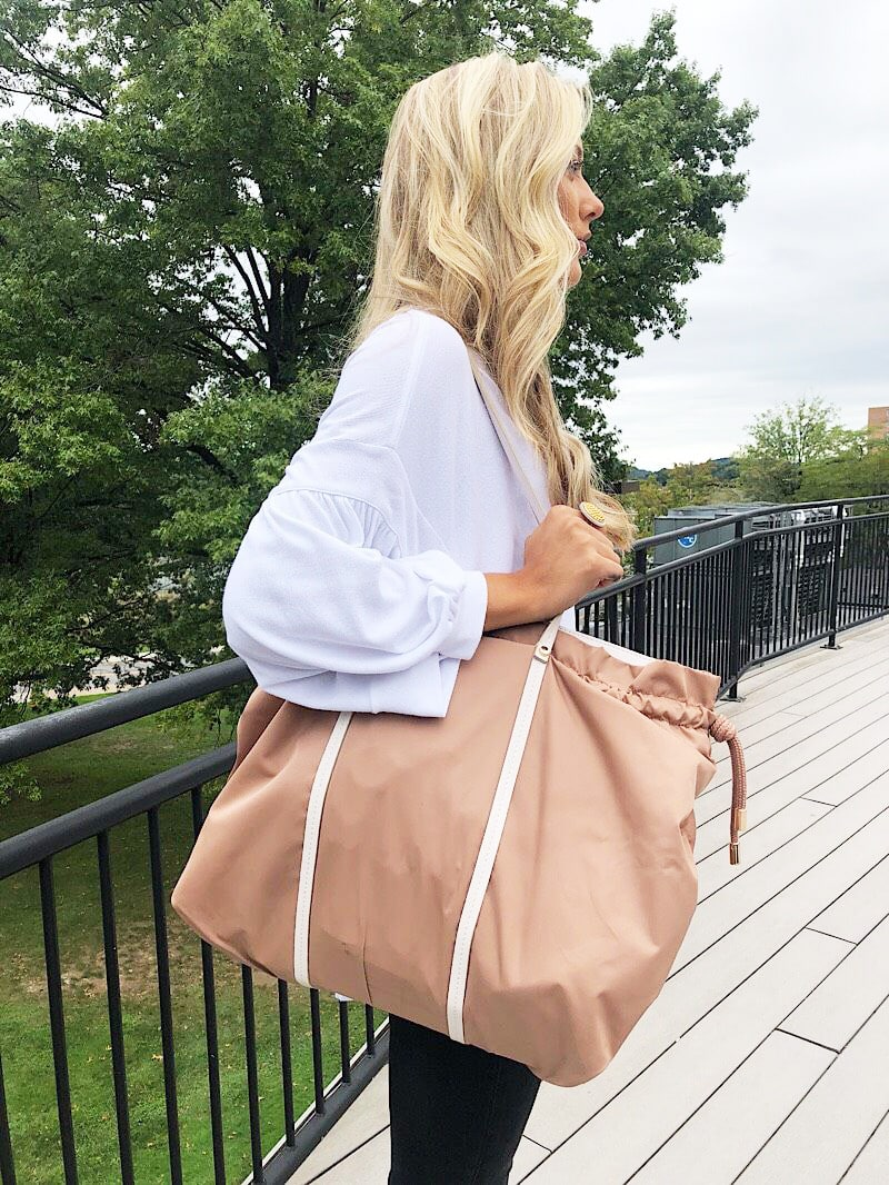 WVU student Gabriella's extra-large brown tote bag has contrasting cream straps.