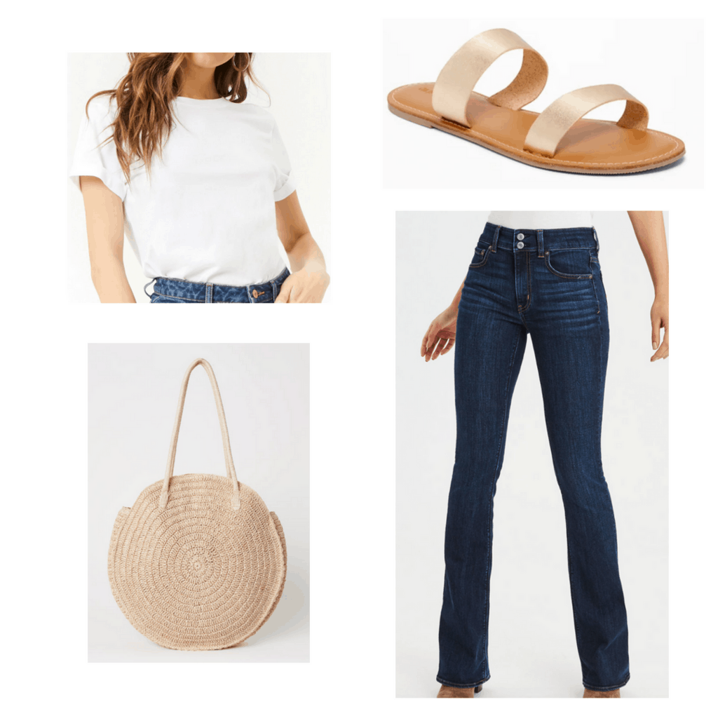White t-shirt with high-waisted flared jeans, gold strapped sandals, and round straw bag