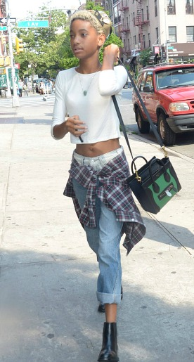 Willow smith wearing a plaid shirt tied around her waist