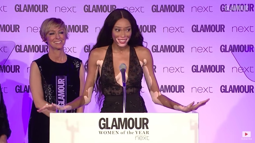 Winnie accepting women of the year award at Glamour event