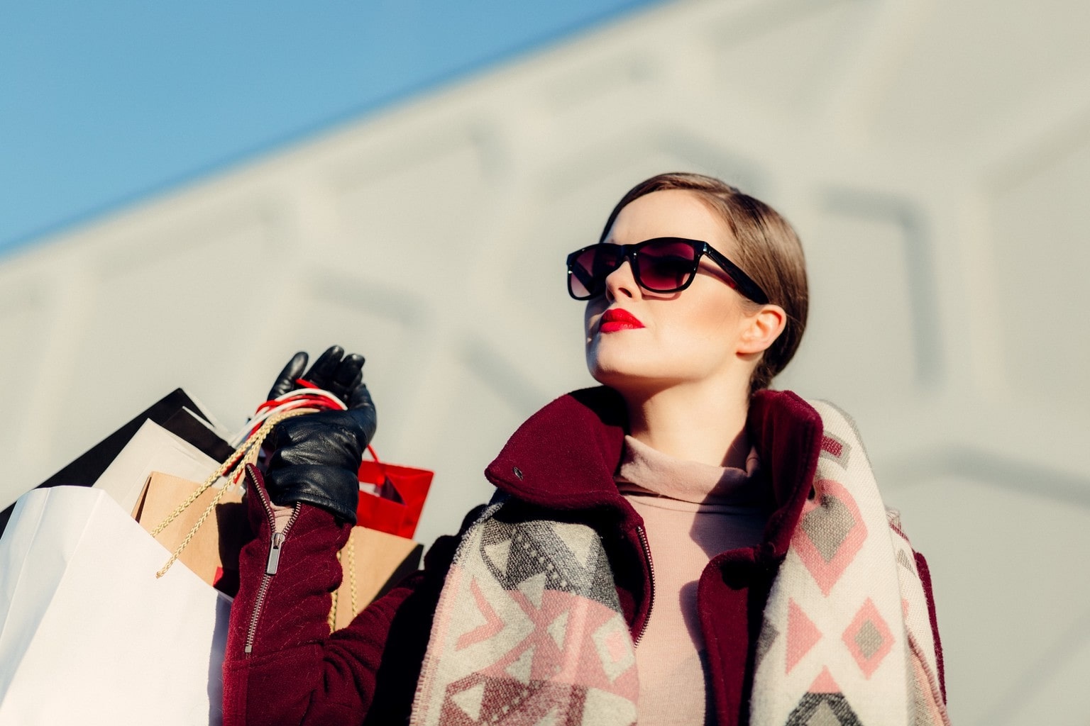 Woman in Sunglasses Holding Shopping Bags