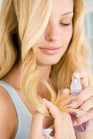 Woman spraying hair product
