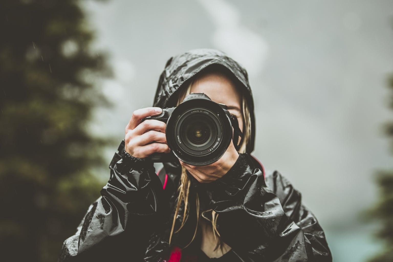 women-taking-photos-in-the-rain