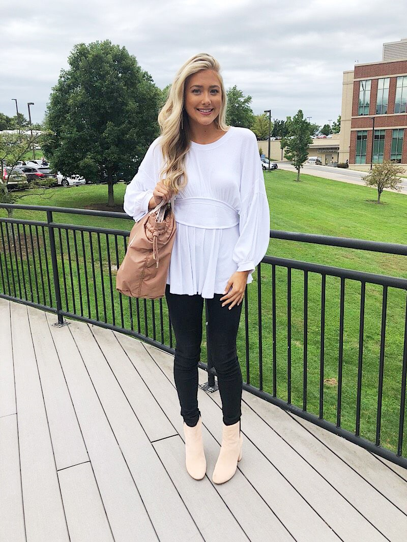 WVU student Gabriella wears a casual white tunic with bell sleeves.