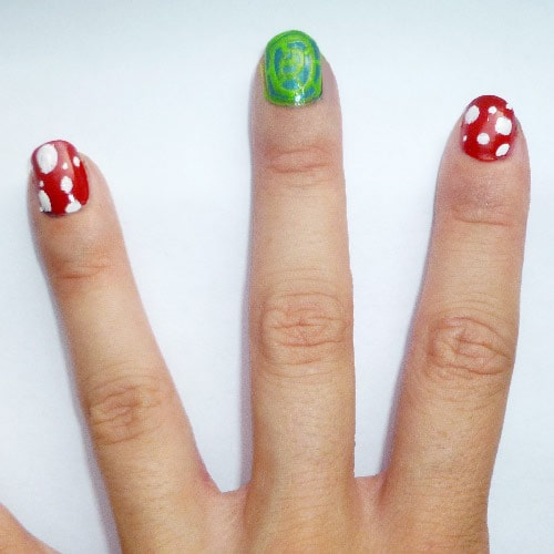 Yayoi Kusama nail art: White dots on red nails