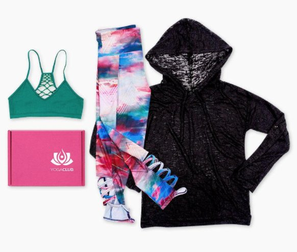 Yoga club subscription box with three athletic pieces around it.