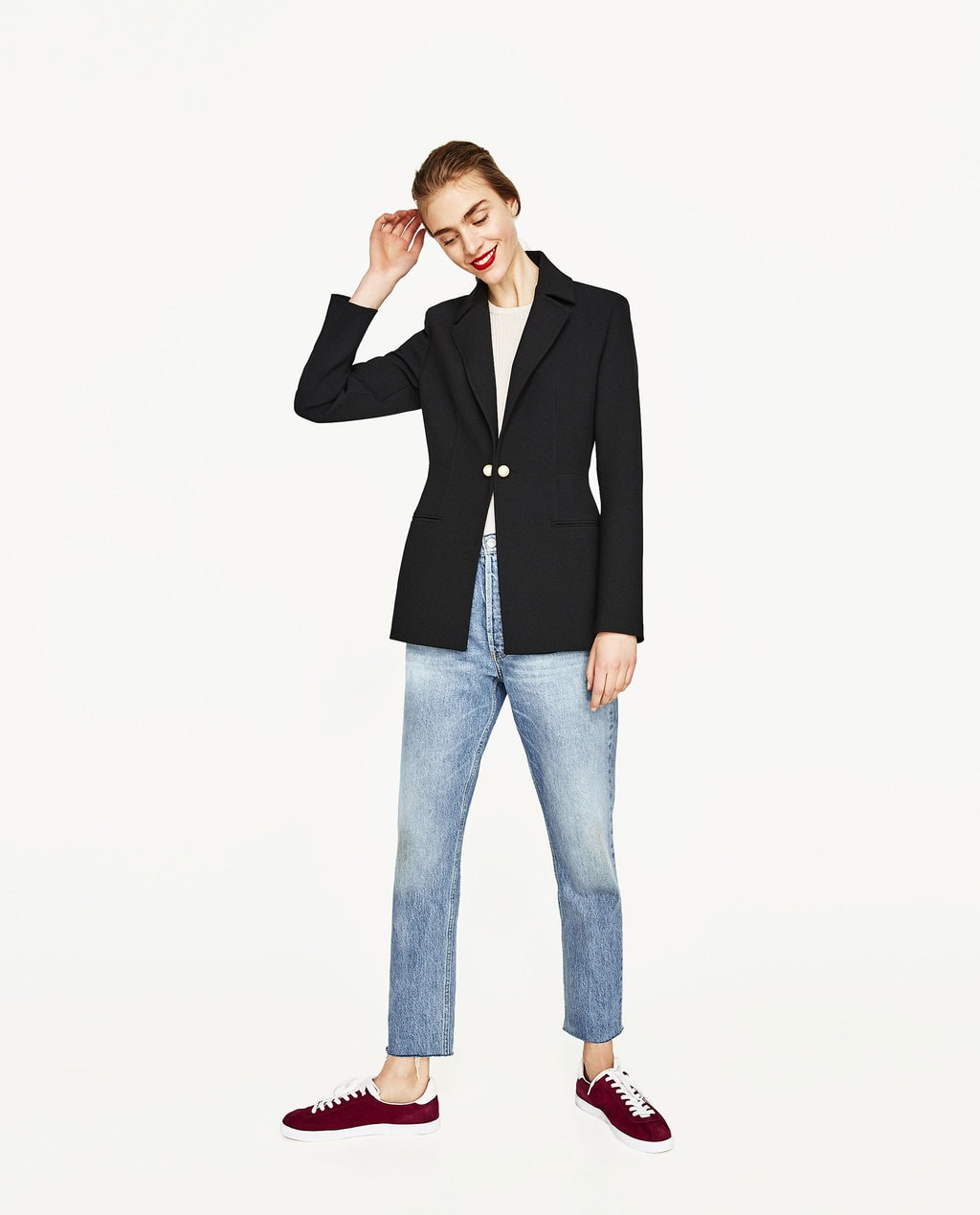 Zara black blazer with pearl closure, worn with white t-shirt, light-wash jeans, and red sneakers