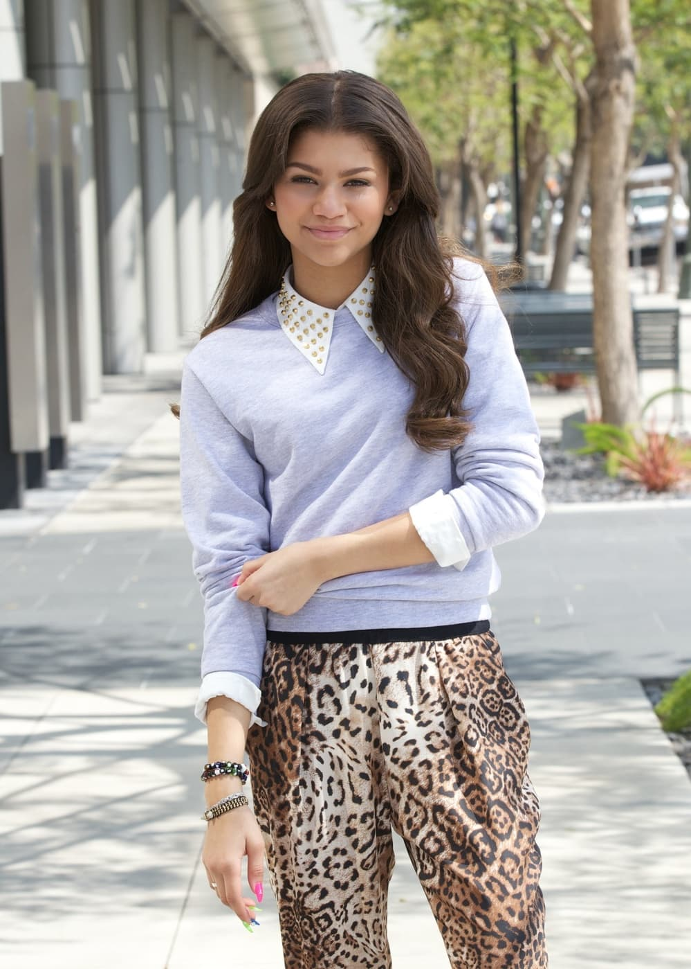 Zendaya in 2013, leopard print pants and collared sweater.