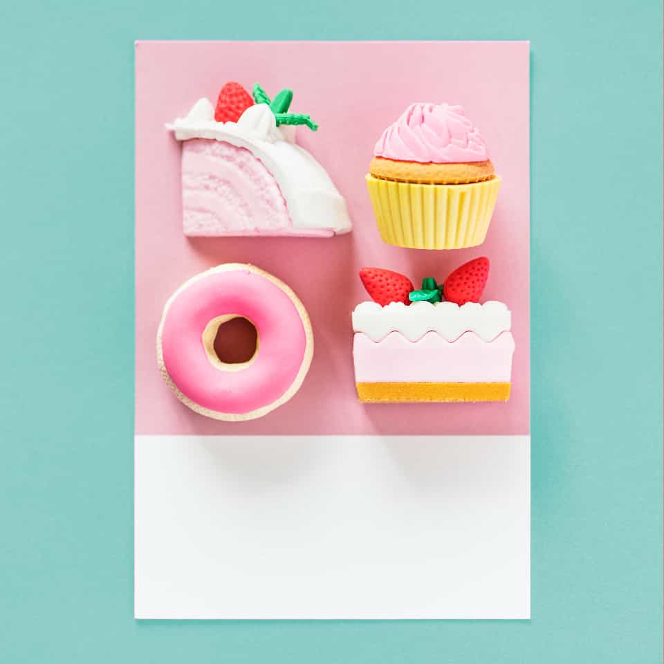 Birthday card with 3D pink cake slices, cupcake and donut