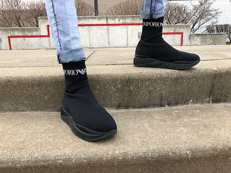 College student Kevin rocks black sock sneakers from Emporio Armani