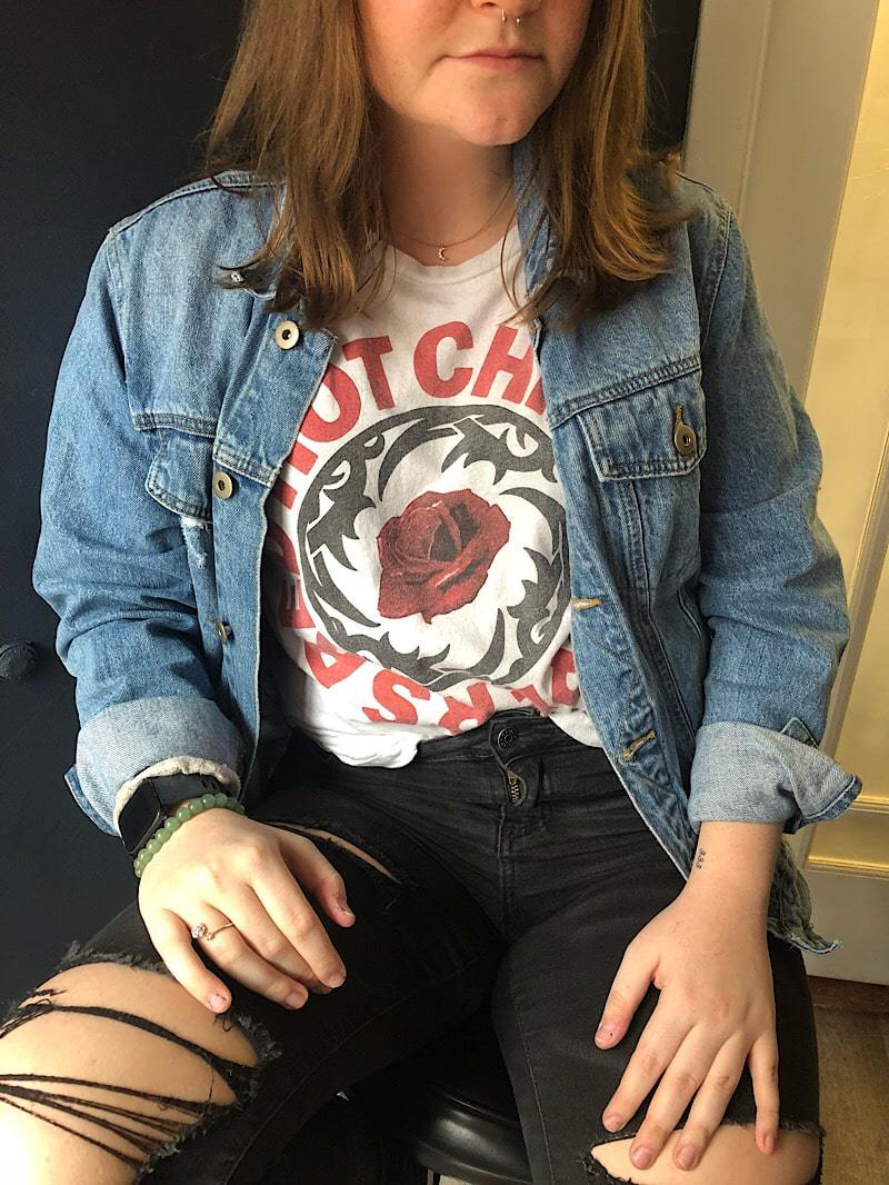 WVU student Tiana wears a Red Hot Chili Peppers graphic tee with a mens denim jacket.