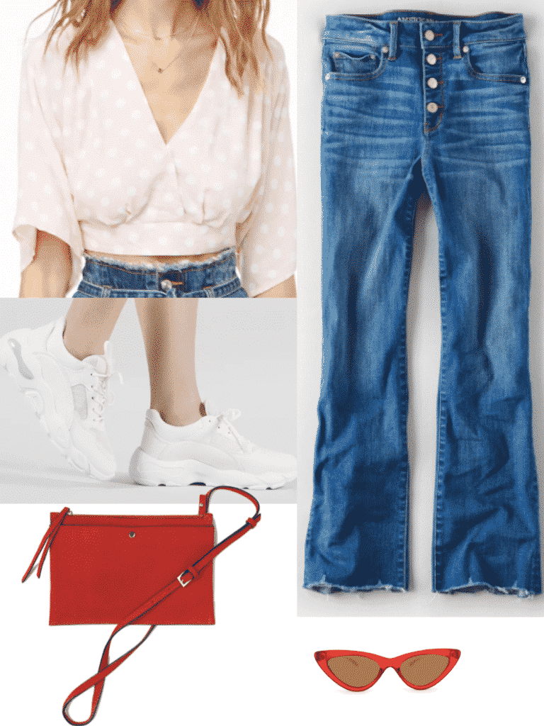 Hailey Bieber outfit with medium wash flare jeans, pink polka dot top, white sneakers,