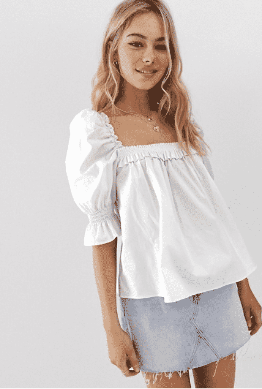 girl in ASOS white babydoll top with puffy sleeves