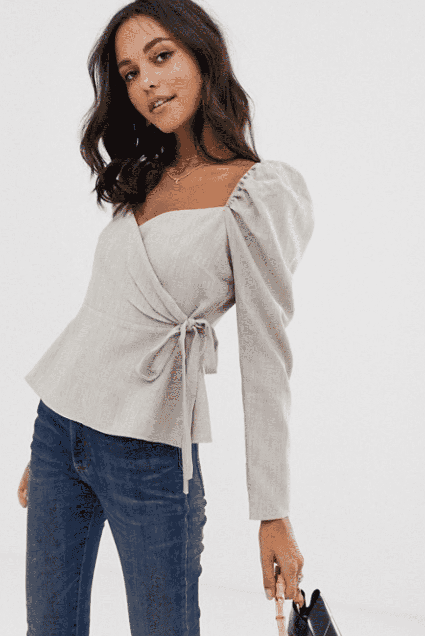 girl in ASOS grey wrap top with puffy sleeves