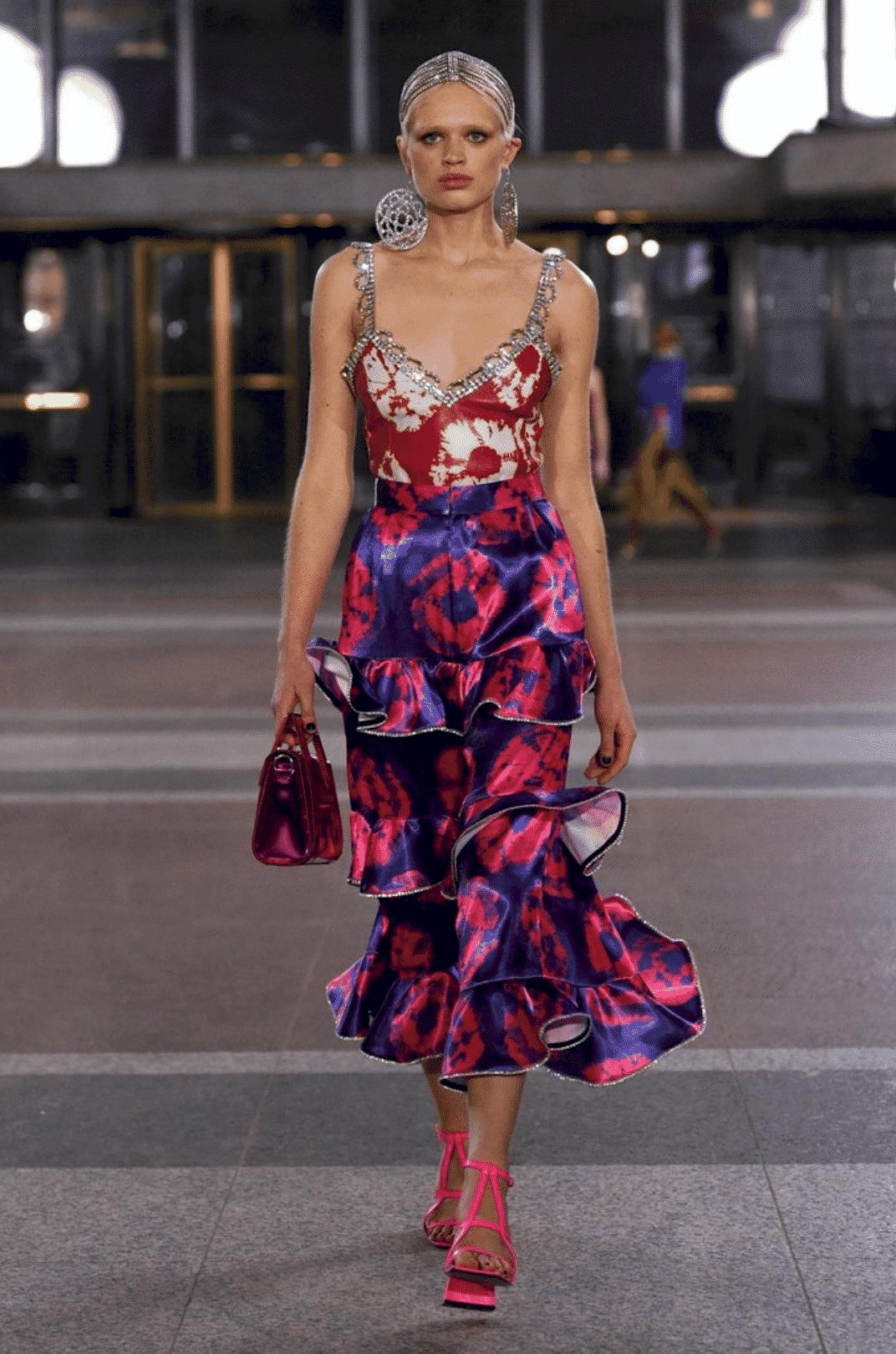 model wearing a tie dye tank top, tie dye midi skirt, and pink heels