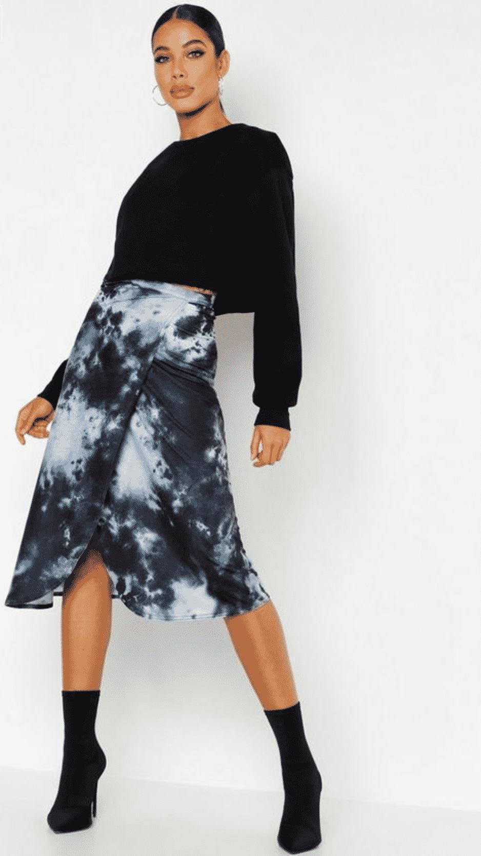 model in a wrap tie dye midi skirt
