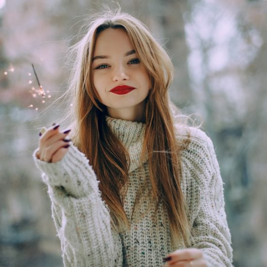 Girl holding a sparkler and wearing red lipstick