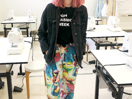 WVU campus style: Funky outfit on Sonora who wears printed pants, fashion week tee, and denim jacket with pink hair