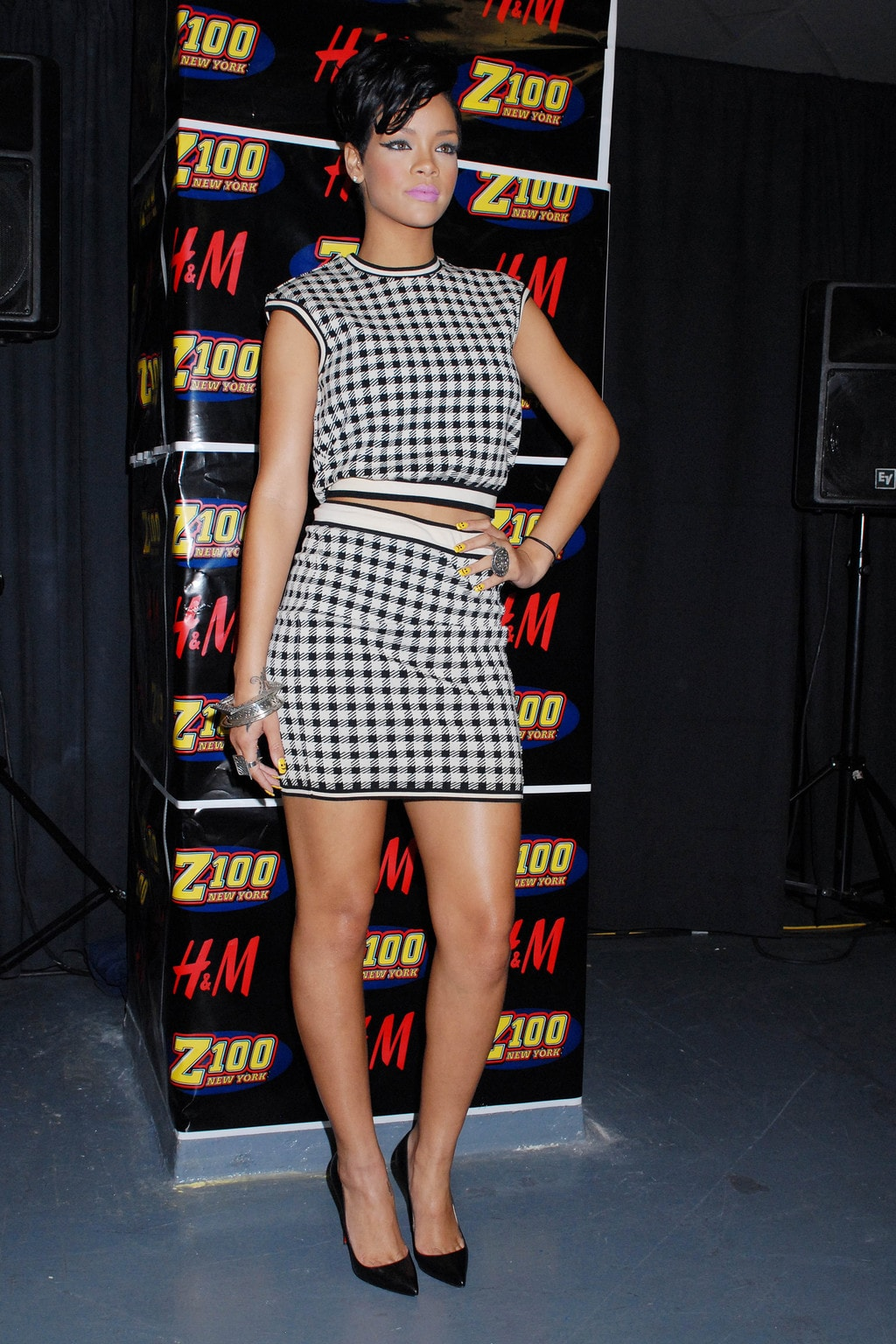 rihanna posing in a matching top and skirt checkered set