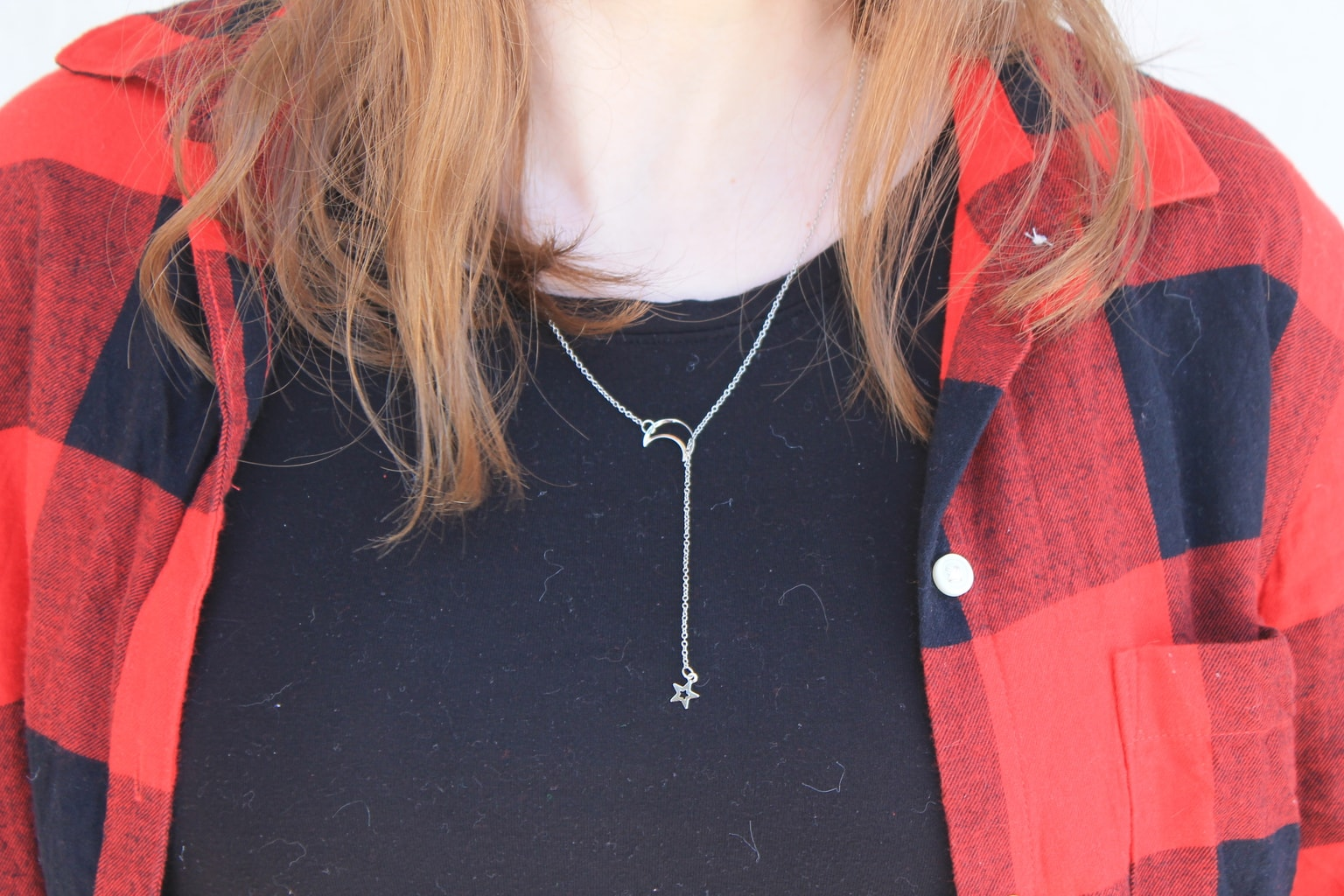 Genna's necklace is a simple lariat with a moon and star.