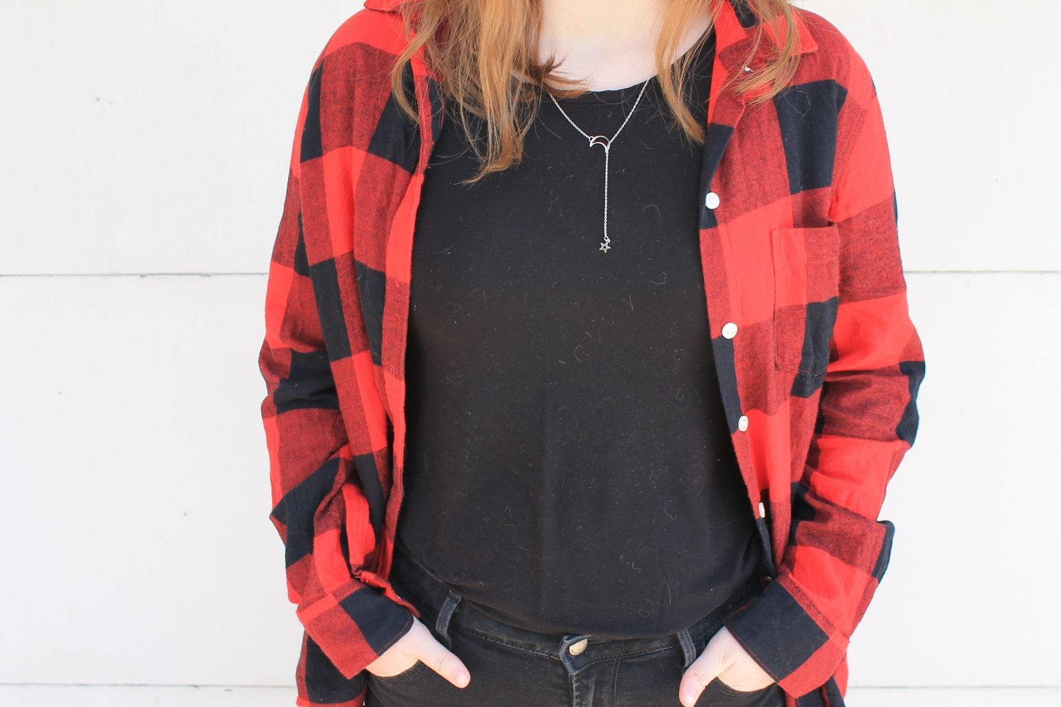 This Grand Valley State University student pairs her oversized red and black flannel with a casual black tee shirt.