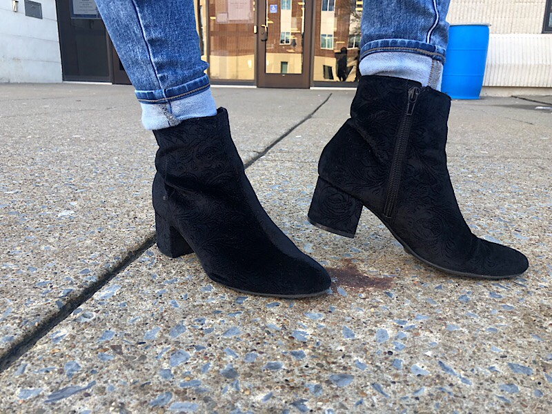 Bella sports chunky low-heeled black booties.