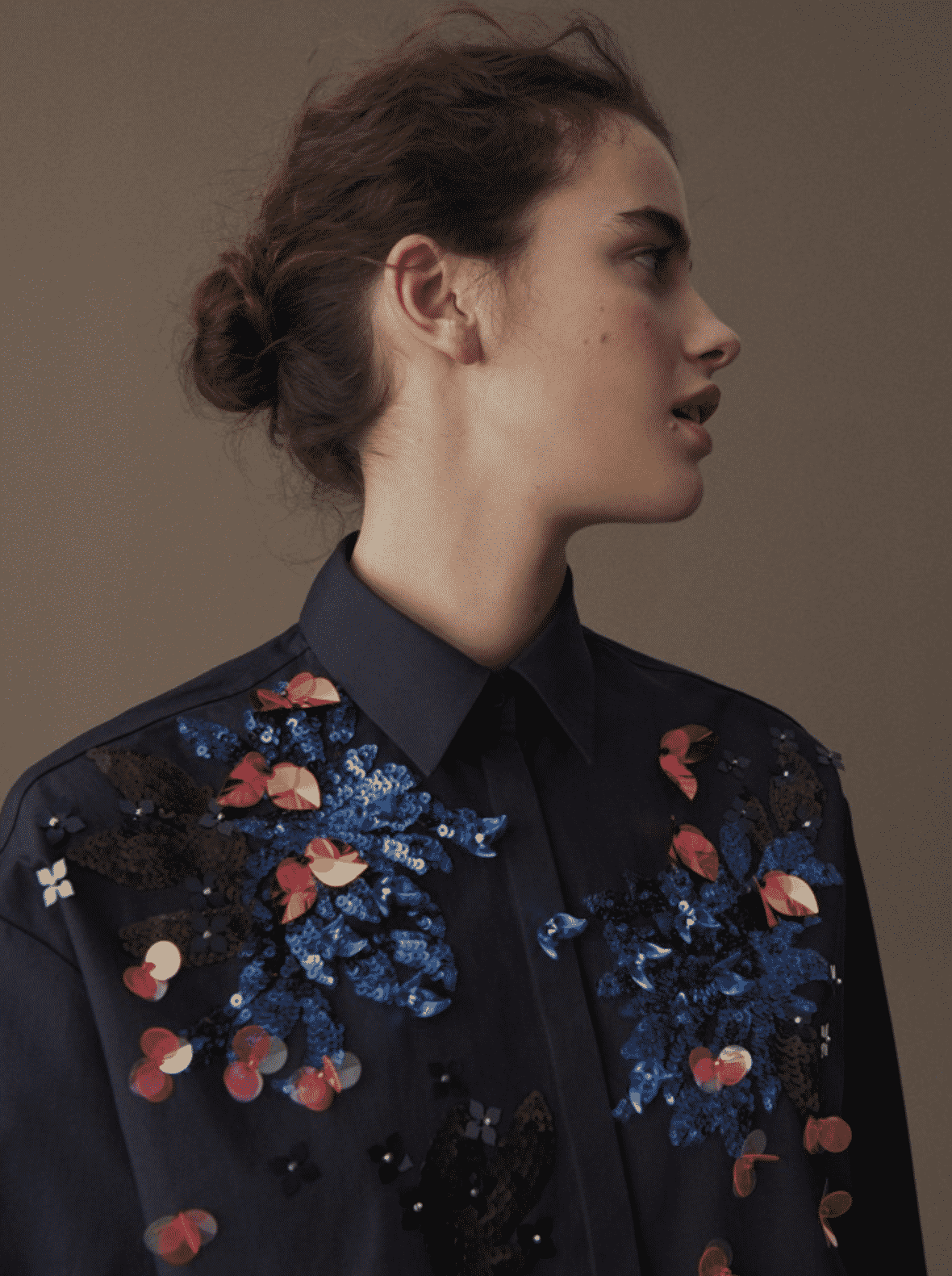 model wearing navy button up top with sequin accents