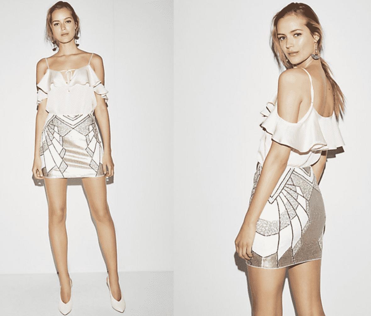 model in sequin mini skirt