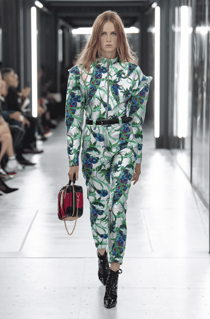 model with paisley pant suit and handbag