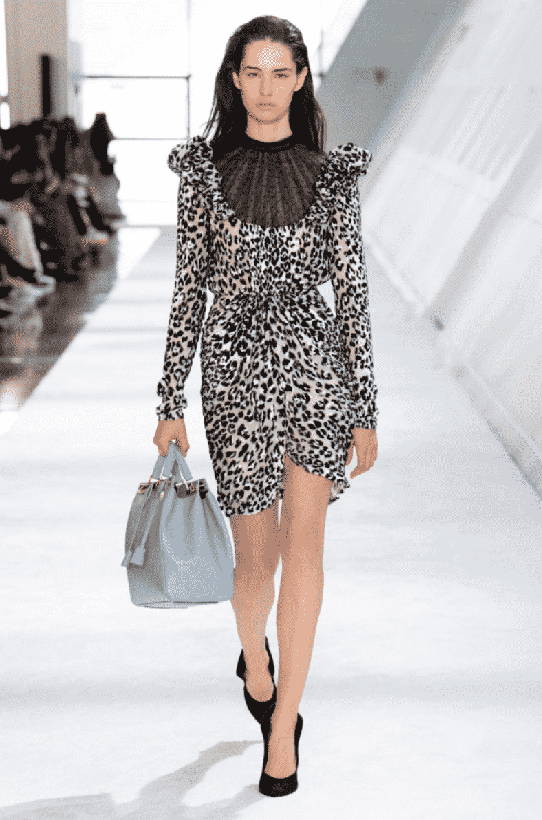 model with leopard dress and handbag