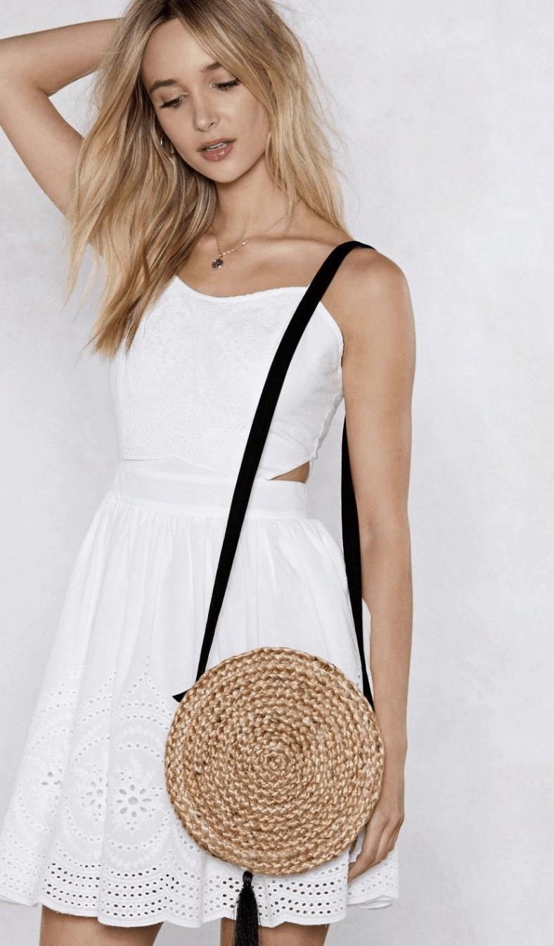 model wearing tan circle woven crossbody bage