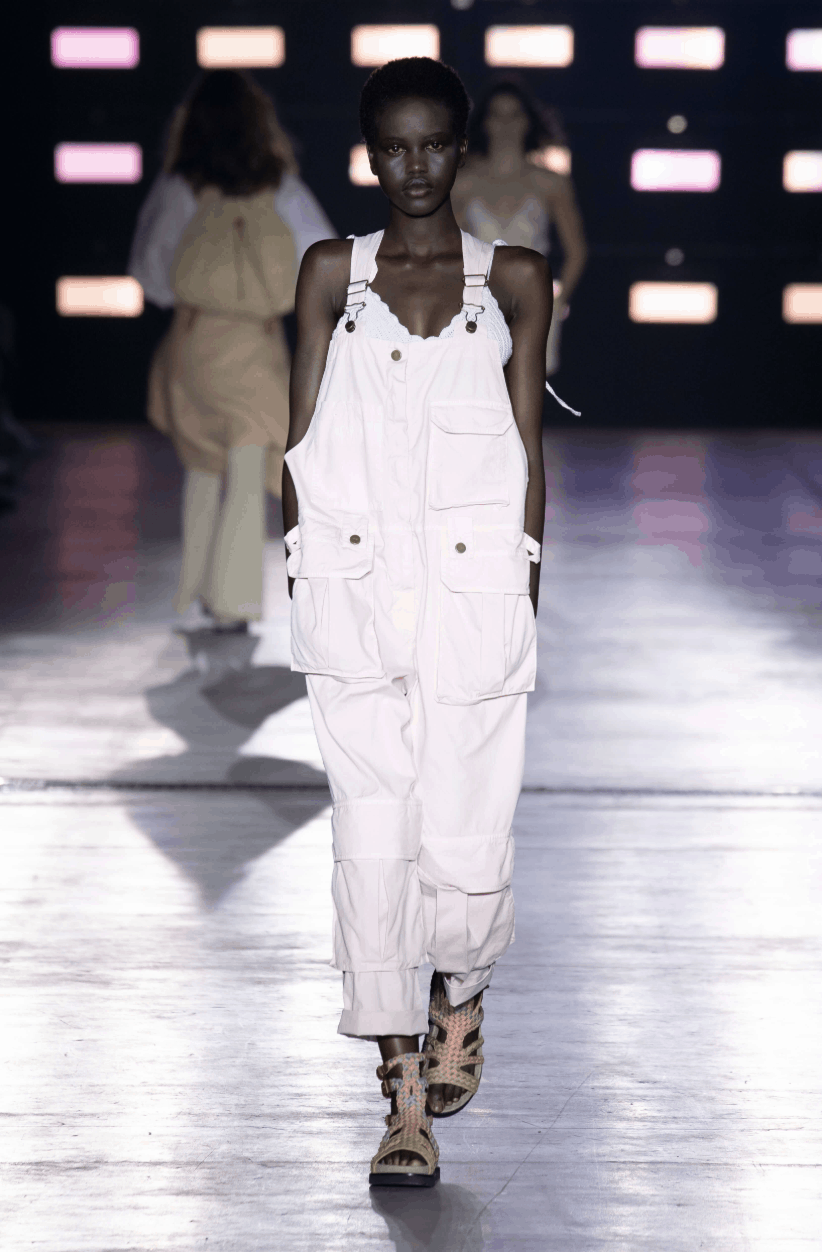 model in overalls covered in pockets