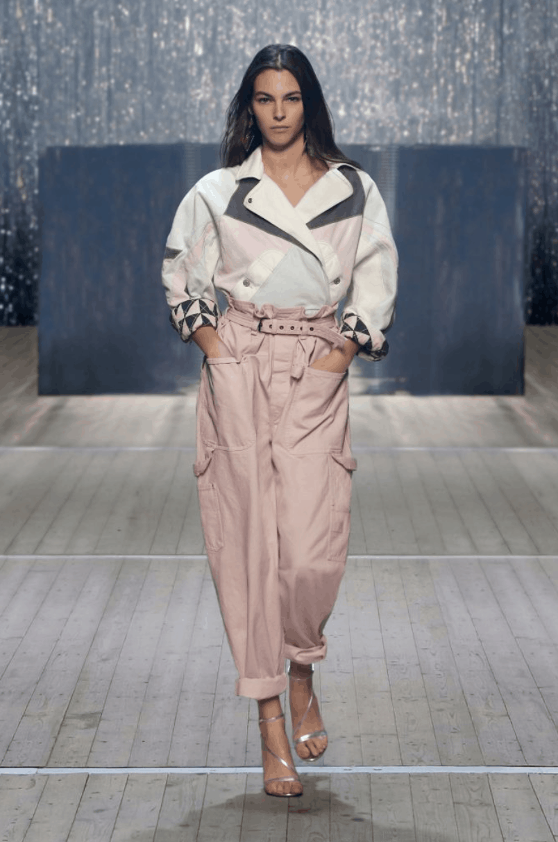 model in a colorblocked jacket and trousers with pockets