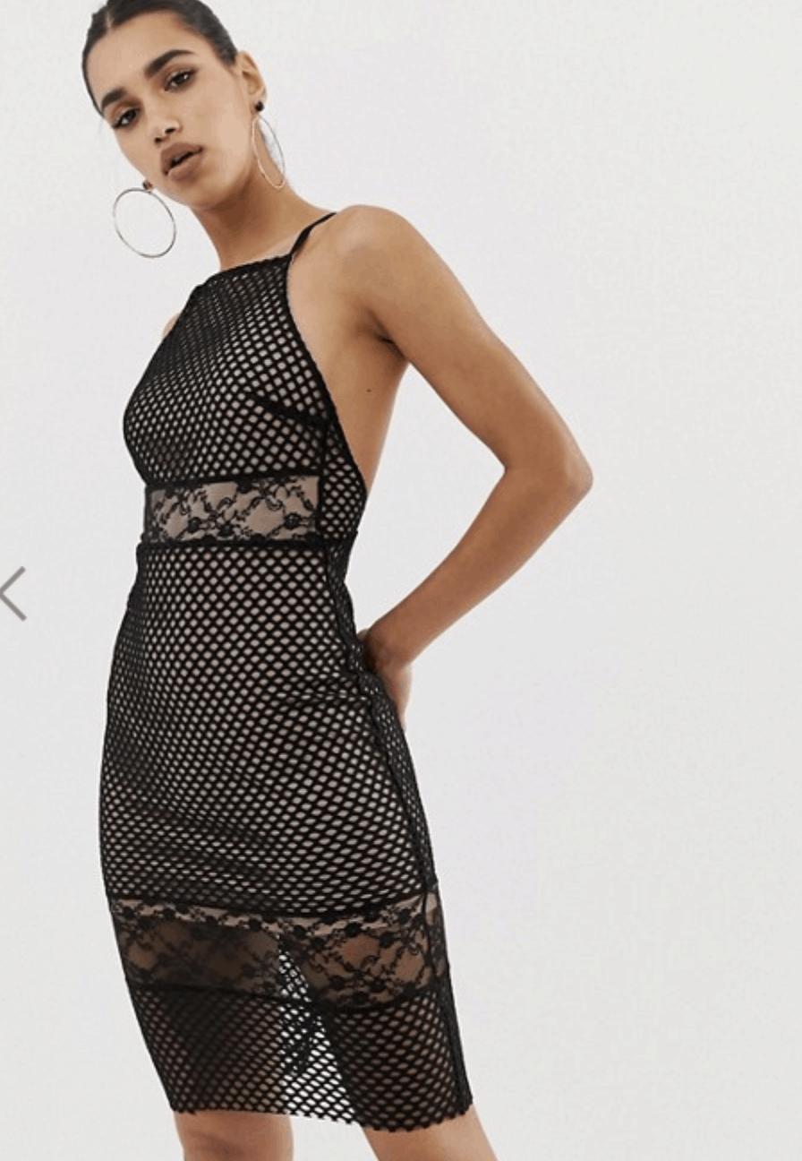 model in high-neck black net midi dress