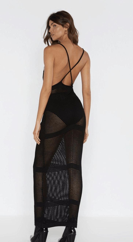 model wearing a net maxi dress in black