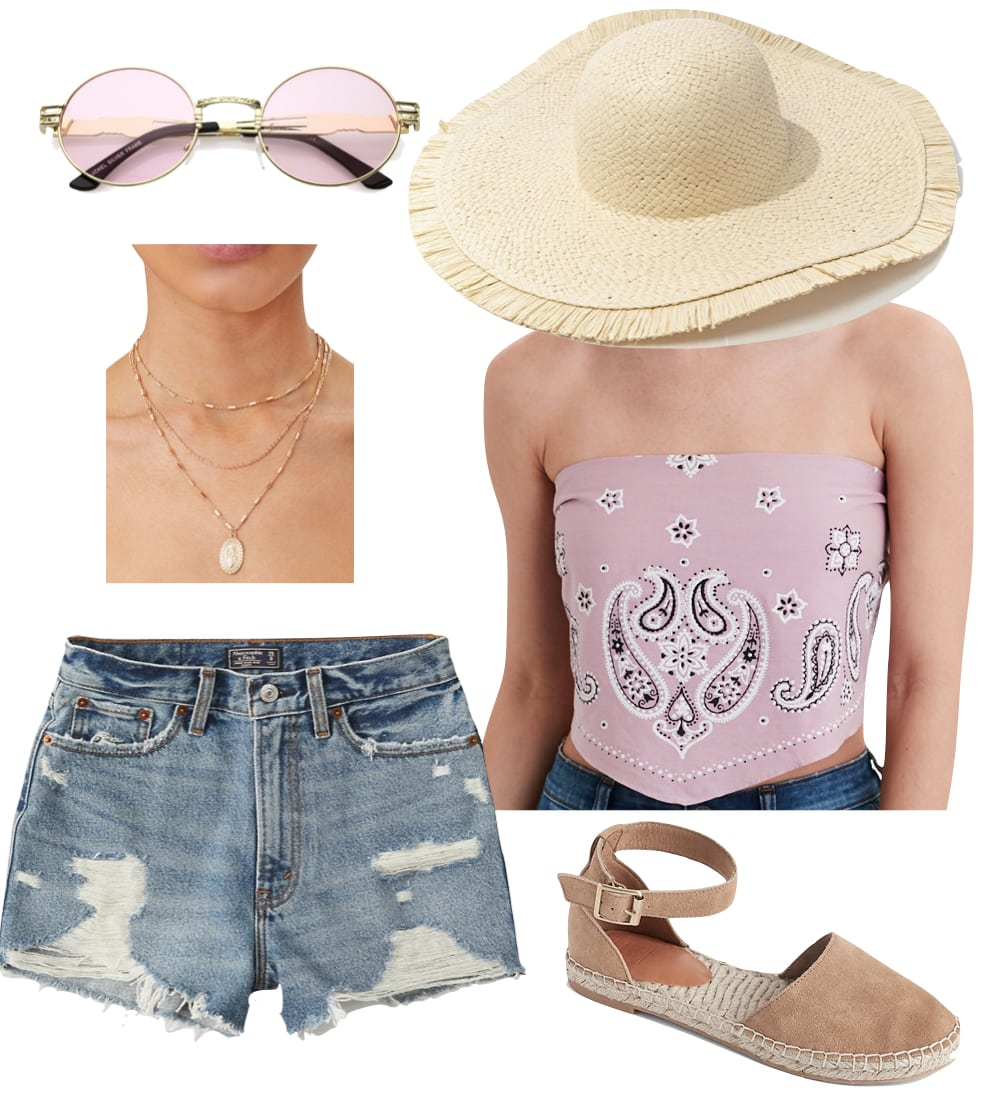 Vanessa Hudgens Outfit: bandana crop top, distressed high rise jean shorts, layered gold necklaces, straw wide brim hat, oval sunglasses, and taupe espadrilles